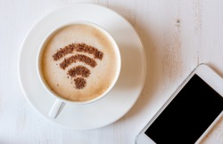 WiFi symbol made of cinnamon as coffee decoration of cappuccino.