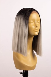 Wig bob straight ombre gray blond hair on a mannequin on a white background
