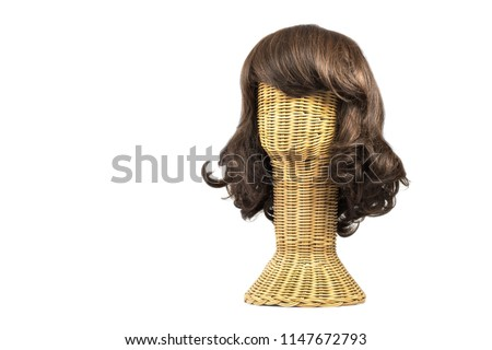 Wig on the forged head made of rattan isolated on white background