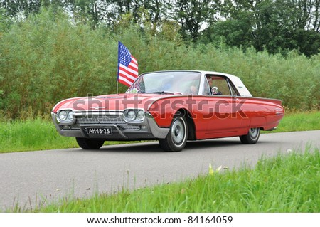 WIJHE, THE NETHERLANDS - SEPTEMBER 4: A Ford 390S from 1961 drives past at the 10th Diekdaegen classic car tour on September 4, 2011 in Wijhe, The Netherlands