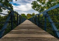Wild angle view, long walkway with yellow line in urban city, perspective and vanishing point