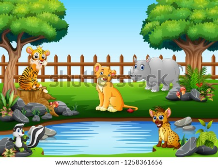 Wild animals playing on the edge of a beautiful small pond #1258361656