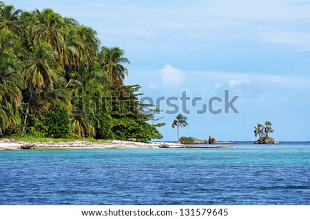 Wild beach with lush tropical vegetation in Zapatilla cayes, two islands located in the Bocas del Toro archipelago, Caribbean sea, Panama