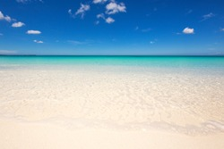 Wild beach with white sand and clear water. Wave in the sand and blue sky. Dominican Republic, Barahona Bahia de las Aguilas. Best beaches of the world