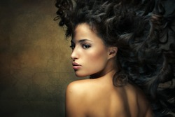 wild beautiful black hair woman shot with hair in motion