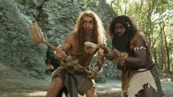 wild caveman of prehistoric period hunting for animal food in the forest. Primitive homo sapiens. Evolution acnestors.