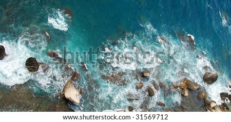 Wild corsican sea background from above with boulders facing the ocean