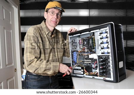 http://image.shutterstock.com/display_pic_with_logo/7096/7096,1236978745,1/stock-photo-wild-eyed-computer-geek-working-on-the-inside-of-a-pc-computer-with-a-screw-driver-26600344.jpg