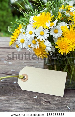 wild flowers and label on wooden ground/wild flowers/spring - stock photo