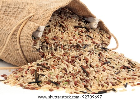 Wild rice in a hessian sack and loose over white background.