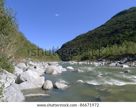 Wild river on a sunny bright day - stock photo