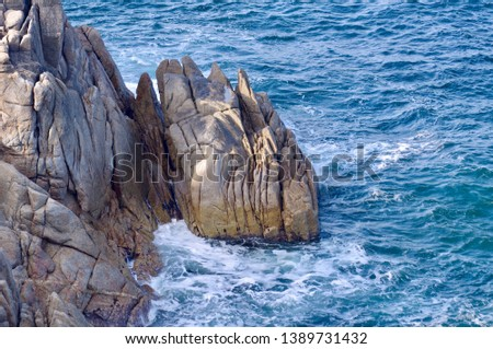 Wild rocks and tingling wave #1389731432