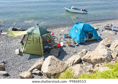 wild tourist camping on desert beach on the russian reserve isle Reinike