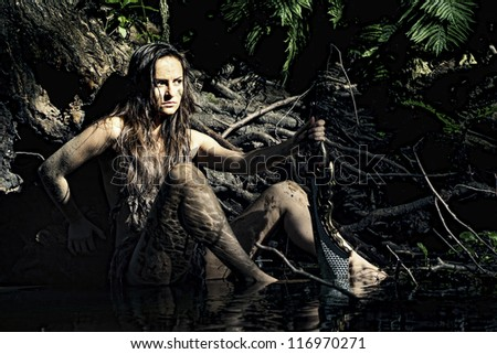 Wild woman posing with a loincloth on the nature