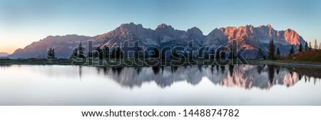 Wilder Kaiser on a lake in Going