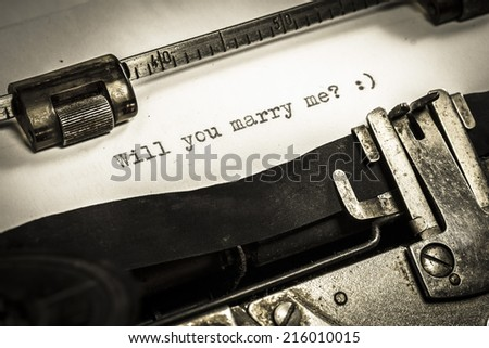 Will you marry me, messages type on old typewriter. Sepia, low light.
