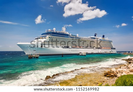 WILLEMSTAD, CURACAO - APRIL 10, 2018:  Cruise ship Celebrity Eclipse docked at port Willemstad. The island is a popular Caribbean cruise destination
