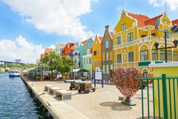 Willemstad, Curacao. Dutch Antilles.  Colourful Buildings attracting tourists from all over the world. Blue sky sunny day.