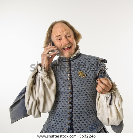 William Shakespeare in period clothing talking on cell phone.