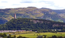 William Wallace Monument seen in the distance. Photo taken from the walls of Stirling Castle in Stirling, Scotland, UK.