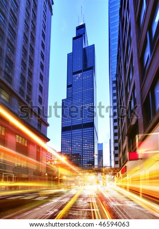 Willis Tower and modern city at night with freeway traffic