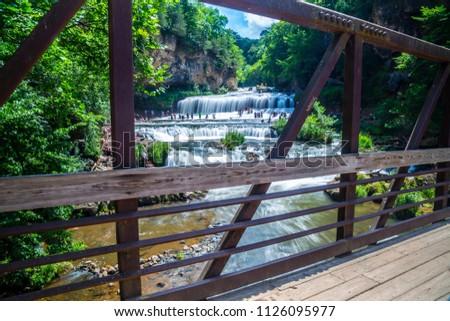 Willow River long exposure waterfall water fall river stream bridge iron rust outside park swim swimming heat