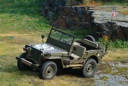 Willys - old fighting jeep in rock terrain