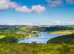 Wimbleball Lake Exmoor National Park Somerset.  It is well known for its activity centre and is popular for walking, camping, birdwatching, angling, sailing, windsurfing, canoeing, rowing etc