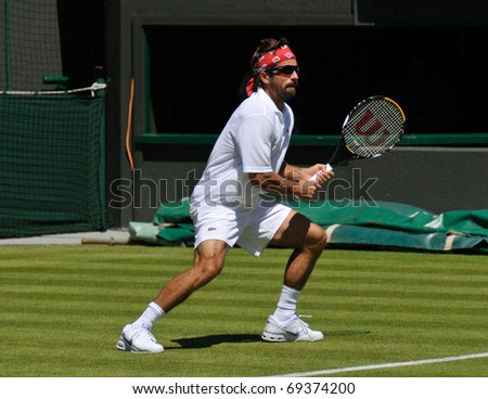 WIMBLEDON, LONDON - JUNE 23: Arnaud Clement during his 3-6 1-6 2-6 defeat to Argentine Juan Martin Del Potro on June 23, 2009, in his First Round match on Court 11.