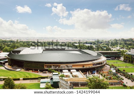 Wimbledon stadium under sunny blue sky day with green trees and parks around London skyline in horizon #1424199044
