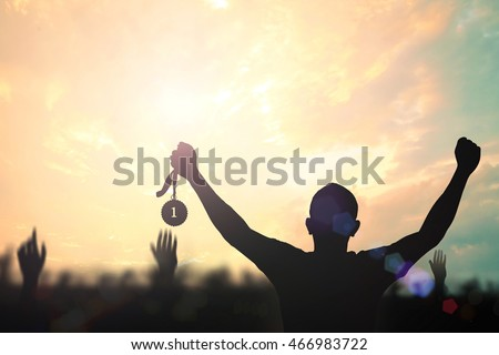 win concept. human holding gold ...