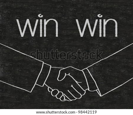 win win business with shake hands symbols written on blackboard background high resolution