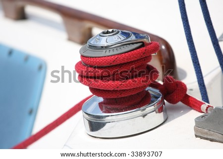 Winch and red rope on a sailboat