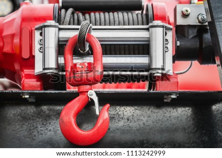 winch with hook for self-pulling stuck machinery. Parts and parts of construction equipment