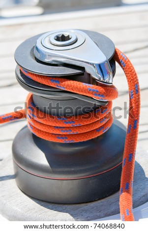 Winch with red rope on sailing boat