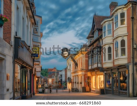 Photo of  Winchester City centre High Street at night during mid-summer