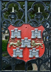 Winchester, Hampshire, UK's coat of arms composed of castles and lions forming an heraldic shield.  The Arms were first recorded by the Heralds during their visitations between 1622 and 1686.