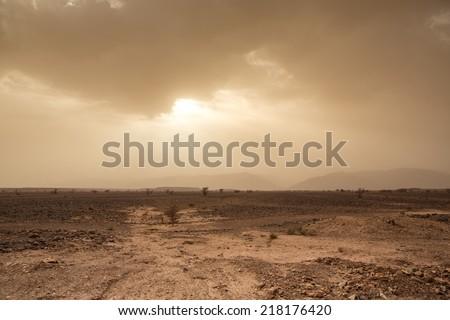 Wind and skittish sky in the desert of Sahara in Morocco