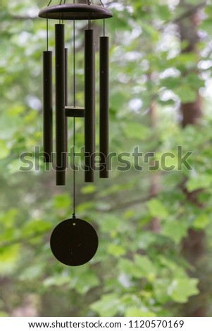 Wind chime with forest background
