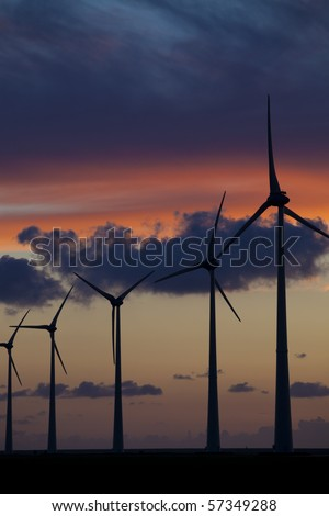 Wind energy turbines at sunset