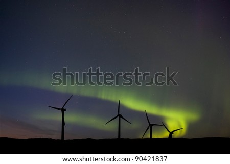 Wind Farm And Northern Lights Aurora Borealis Canada - stock photo