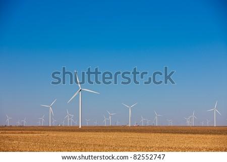 Wind Farm in Farm Wheat Field under Clear Blue Sky