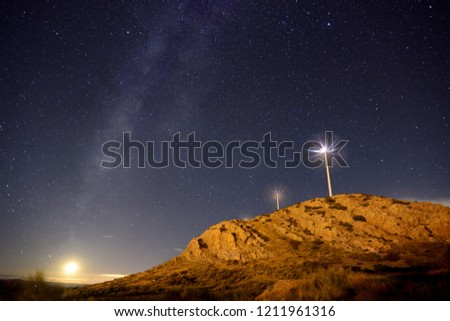 Stock Photo Wind farm in its surroundings and night landscape.