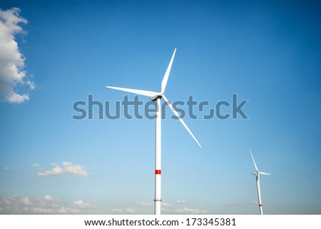 Wind farm standing against bright blue sky Stock photo ©