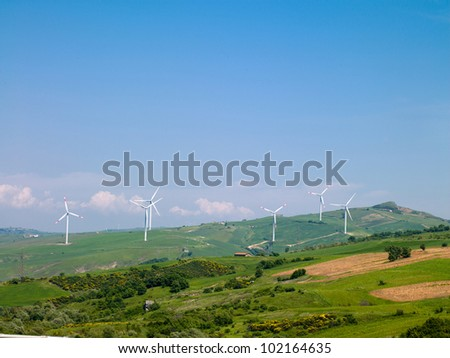 wind farms in Italy against the blue sky and nature