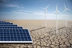 Wind generators and solar panels in the desert. Renewable energy sources. Concept