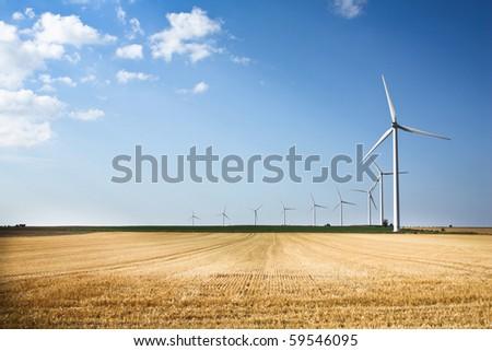 Wind generators in a row - stock photo