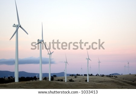 Wind generators sit separated along the hilltops of a modern wind farm.