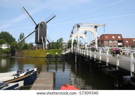 Wind mill and drawbridge in Leiden, Holland