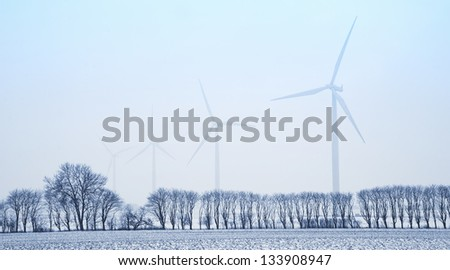 Wind mills in the landscape at wintertime. - stock photo